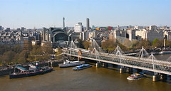 view over to Charing Cross station and Hungerford Bridge (Scorpions and Centaurs) Tags: city uk england london thames river fun boats view britain sightseeing flight londoneye vista ferriswheel touristattraction hungerfordbridge charingcrossstation