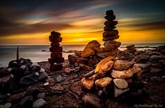 Rock Art at Sunset (MyWorldThroughMyLens) Tags: stouen jersey je rocks art pebbles pillars sunset lowsun clouds cloudtrails sea seaside seascape