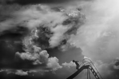 Fearless (Kapuschinsky) Tags: blackandwhite bnw monochrome fineart fineartportrait candid candidchildhood childhood negativespace clouds dramaticclouds dramaticsky sky summer summertime playground slide emotive moody silhouette