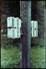 Boxes upon boxes attached to a pole. (FreezerOfPhotons) Tags: olympus35sp konica160pro unicolorc41