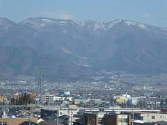 Town in the valley (seikinsou) Tags: japan spring omiya kanazawa shinkansen jr railway train travel hakutaka windowseat view mountain snow town cable valley plain
