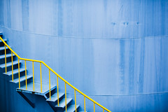Climbin Iron Sky (Éole) Tags: auckland newzealand nz blue yellow iron silo cistern metal minimal minimalism industrial