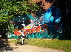 Ruelle Chateaubriand, Montral (Exile on Ontario St) Tags: graffiti montral murale chteaubriand montreal bike bicycle vlo cycliste cyclist cyclisme bicyclette chateaubriand streetart publicart artpublic urban art street urbain public wheels girls shorts plateaumontroyal sunny ensoleill soleil legs t summer ruelle ruelles alleys alleyways alleyway alley riding