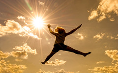 a little higher (JimfromCanada) Tags: jump leap sky sun sunburst summer sunny gold golden girl play trampoline bounce star fun cloud ontario