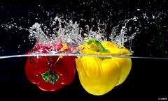 Washing peppers (gifu88) Tags: flash water healthy colors splash red yellow darktable gimp mfl pancolar 50mm
