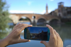 Verona from a cellphone (simone781) Tags: smartphone pictureinpicture woman hands river verona adige sunset pontepietra beautiful