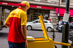 DHL Delivery (Michael Goldrei (microsketch)) Tags: photo bicycle dhl street delivery mayfair bike 2016 35mm september red typ240 photos man courier leica london st 240 photography cycle 16 typ type240 yellow photographer sept