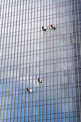 Two Teams Cleaning Skyscraper Windows (danliecheng) Tags: building cleaner cleaning contemporary danger equipment exterior four glass group hang helmet job lines modern pattern people ropes safety skyscraper team two windows workers