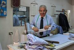 Chemiserie       Stranger 16/100 (Ruth Moucharafieh) Tags: lebanon clock shop work jesus tie shirts elderly beirut tapemeasure achrafieh chemiserie