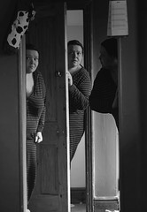 Me, me and me 1 (Erminger) Tags: door light portrait bw woman white black self bag cow calendar emma clone cloned onesie erminger