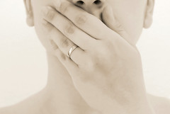 Silence is gold (Claudia Foti) Tags: portrait face sepia golden monocromo hand ring silence dreams