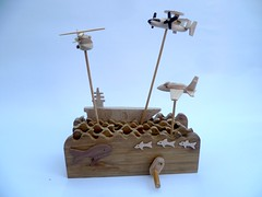 US Navy Small Ship, planes and helicopter (Wanda Sowry) Tags: wood sea colour toy handle moving wooden movement waves ship parts cam aeroplane helicopter hawkeye hornet aircraftcarrier usnavy cog mechanism automata automaton usscarlvinson seahawk fa18 h60
