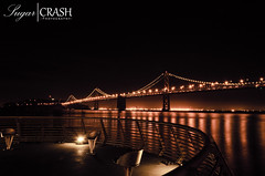 Oakland Bay Bridge (OmegaMoth) Tags: sanfrancisco california city bridge urban orange black water monochrome beautiful architecture night lights bay pier nikon monochromatic september adventure journey dslr 2012 oaklandbaybridge d7000 nikond7000 sugarcrashphotography
