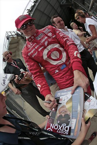 Scott Dixon signs an autograph for a fan