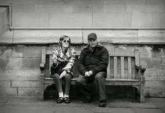 love songs in age (yorktone) Tags: street camera york light shadow portrait blackandwhite bw woman white man black art love monochrome socks writing dark lumix photography mono photo words hands couple decay sandals cigarette candid yorkshire streetphotography monotone anger photographic smoking elderly age fist angry british smoker g3 philip tone songs larkin clenched wringing yorktone