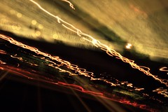The Golden Era (DLolly) Tags: road street light red cloud black cars yellow night dark word gold lights golden words traffic bokeh flare streaks lightstreaks goldenlight supershot abigfave