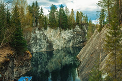 Lake in the marble quarry (Chizury) Tags: ifttt 500px lake water sky reflection trees tree green forest summer sun blue clouds light travel day russia karelia russian federation boat outdoor marble quarry