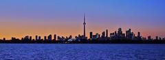 Toronto, Canada (LakeRidge Photography) Tags: toronto ontario skyline sunset panorama cntower skyscraper towers highrise lake mirror reflection islabd colour color dramatic rogerscentre dome skydome arena stadium sports lights blue jays