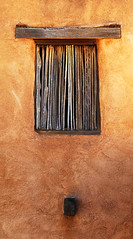 Upper Window in the Chapel (studioferullo) Tags: old arizona brown abstract building texture window lines wall architecture contrast rural outside outdoors gold design gallery glow desert bright tucson outdoor country sunny chapel line adobe viga minimalism ochre sanctuary degrazia