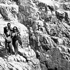 A selfie of three girls on the rocks (pedrosimoes7) Tags: beach candid rocks girls photographing selfie blackandwhite black white bw creativecommons cc