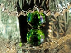 Sugar Bowl on Marble on Mirror (clarkcg photography) Tags: cutglass sugarbowl serratededge angles teeth sugarbowledge marble glass green lights light macromondays mirror