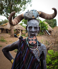 Mursi Woman, Ethiopia (Rod Waddington) Tags: africa african afrika afrique ethiopia ethiopian ethnic etiopia ethnicity ethiopie etiopian thiopien omovalley omo river portrait lipplate horns village mursi traditional tribe tribal outdoor huts