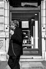 Business (-Andreyes- www.andreabastia-photo.com) Tags: bn biancoenero uomo people camminare ascoltare parlare auricolare piazza via strada piazzaunit trieste vetrina messaggio affari business wwwandreabastiaphotocom