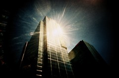 daydream #4 (mugley) Tags: city windows sky urban sun sunlight colour reflection film glass architecture modern corner 35mm buildings grid cityscape glare afternoon shadows skyscrapers kodak towers grain angles australia melbourne wideangle victoria southerncross scan crappycam negative flare epson sunburst boxes cbd 135 vignetting sx1 offices kodakgold100 urbanlandscape bourkest australiapost c41 22mm gold100 v700 keystoning exhibitionst vivitarultrawideandslim wideslim sx2 eximus eximuswideandslim