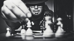Play the opening like a book, the middle game like a magician, and the endgame like a machine (Mayank Sharma renewed :D :D) Tags: portrait bw india selfportrait playing game home me hat canon glasses interesting delhi bangalore perspective chess specs rum concept winters mayank