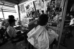 Laos - Vientiane (luca marella) Tags: travel boy people bw white haircut black film girl shop reflections mirror blackwhite asia voigtlander bessa pb bn e barber bianco nero analogic marellaluca