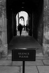 The Silent Silhouettes (Torsten Reimer) Tags: uk england people blackandwhite silhouette sign stone unitedkingdom library tunnel oxford bodleianlibrary silenceplease