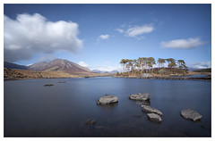 Blue Sky Moment in Connemara (Ashley Lowry) Tags: longexposure blue trees ireland sky white mountain lake mountains galway wet water sunshine pine clouds reflections landscape island big rocks stones hill cogalway hills connemara lee puffy stopper slowshutterspeed pineisland lakescape derryclare derryclarelake 10stopfilter