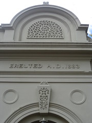 Building Date of the Former Alexandra Mechanics Institute and Free Library  Corner Grant and Perkins Streets, Alexandra (raaen99) Tags: building heritage urn architecture town education pattern architecturaldetail library painted pillar 19thcentury decoration victorian australia victoria institute alexandra victoriana historical column stucco grantstreet 1877 publiclibrary parapet nineteenthcentury 1890s 1892 1883 classicalarchitecture 1870s 1880s countryvictoria grantst mechanicsinstitute adulteducation heritagelisted countrytown billiardhall architecturalfeature northeastvictoria freepubliclibrary architectunknown provincialvictoria perkinsstreet educationalestablishment victorianfreeclassical stuccoedbrick technicalinstitution victorianfreeclassicalbuilding victorianfreeclassicalarchitecture billardsaloon alexandramechanicsinstitute alexandramechanicsinstituteandfreelibrary alexandrafreelibrary alexandrafreepubliclibrary