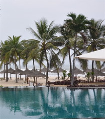 Beach or Pool? (The Spirit of the World) Tags: sea beach pool hotel sand asia waves resort vietnam palmtrees southchinasea danang cabanas photographyforrecreation flickrstruereflection1