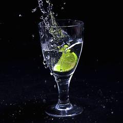 Fruit (forayinto35mm) Tags: water glass fruit sony flash lime wineglass carlzeiss sonyalpha sonya77 sonyalpha77 lineinglass droppedfruitinglass droppedlimeinglass