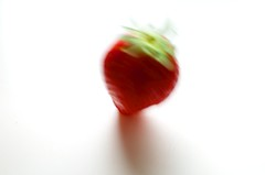 Falling (primitiveprobe) Tags: red motion blur fruit 35mm strawberry nikon highkey catchycolor catchycolorred 35mmf18 d5100