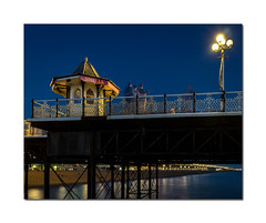 Ghostly subjects (Explored) (hehaden) Tags: sea people beach night reflections lights sussex pier brighton kiosk railings brightonpier palacepier