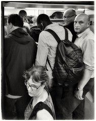 Commuting woes (aistora) Tags: commuting commuter people crowd crowded packed rampacked squashed overcrowded train tube publictransport transport travel traveler passenger passengers boarding board climb enter full overloaded air ventilation breathe suffocate choke experience ordeal life lifestyle city urban office worker phone cellphone smartphone samsung galaxy s7 samsunggalaxys7 android app perfectlyclear snapseed bw blackandwhite mono monochrome film paper analog silver classic retro street