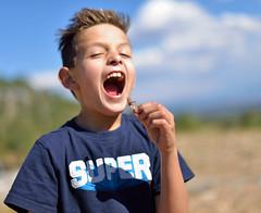 Double Dare (JasonCameron) Tags: kid boy fun funny lol gross grasshopper eat utah mountains peak bug insect