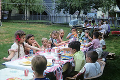Kodachrome memories of times gone by. My sister's 8th birthday party in our back yard. The kids table gets Penguin Cola in steel cans and plates of potato chips. The adult table looks to be engaged in serious conversation. MIlford Conecticut. July 2 1970. (wavz13) Tags: oldphotographs oldphotos 1970sphotographs 1970sphotos oldphotography 1970sphotography vintagesnapshots oldsnapshots vintagephotographs vintagephotos vintagephotography filmphotos filmphotography vintagemilford oldmilford 1970smilford vintagewoodmont oldwoodmont 1970swoodmont connecticutphotographs connecticutphotos oldconnecticutphotography oldconnecticutphotos oldconnecticut vintageconnecticut connecticutphotography vintagenewengland oldnewengland 1970snewengland vintagenewenglandphotography oldnewenglandphotography vintagenewenglandphotos oldnewenglandphotos kodachrome oldslides vintageslides familyslides vintagekodachrome oldkodachrome oldfamilyslides oldfamilyphotos vintagefamilyphotos oldfamilyphotography vintagefamilyphotography vintagekids vintagechildren vintageteens vintageteenagers teenmemories teenagememories vintageclothes oldclothes vintageclothing oldclothing vintagesoda oldsoda 1970ssoda vintagecola oldcola oldcars vintagecars collectablecars collectiblecars oldpontiacs vintagepontiacs vintagecans oldcans collectiblecans collectablecans normanrockwell