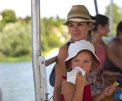 girl eating chocolate ice cream on the boat with her mother (AbdelHadef) Tags: girl eating chocolate ice cream boat with her mother