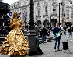 I am not Amuzed (Clare-White) Tags: unanimous thechallengefactorywinner street busking gold guitar london