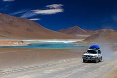 Towards the green lagoon (Johnson Barros) Tags: ferias travel trip vacations viagem lake green road dust landscape