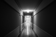 come play with us (270) (Beau Finley) Tags: creepy dc woodleypark washingtondc district columbia nwdc beaufinley monochrome black white bw blackandwhite leadinglines leadlines hallway hall reflection tile asylum building architecture 365 project project365 symmetry