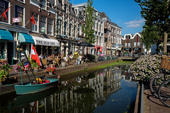 Gouda canal reflections (PaulHoo) Tags: gouda holland netherlands 2016 urban city citylife fuji x70 water canal reflection boat restaurant bar horeca architecture cityscape