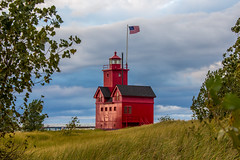 Holland lighthouse - Explore (Kevin Povenz Thanks for all the views and comments) Tags: 2014 september kevinpovenz westmichigan michigan ottawa ottawacounty holland hollandstatepark bigred lighthouse lighhouse canon60d red evening flag grass beach