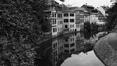 And nothing ever happens, nothing happens at all (lunaryuna) Tags: france lalsace strasbourg urban city architecture buildings medievalarchitecture timberframe canal urbanidyll timecapsule reflections seeingdouble walkinthecity blackwhite bw monochrome lunaryuna