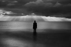 Anthony Gormley (jasonhudson2) Tags: mono monochrome blackandwhite gormley merseyside sunrays clouds moody