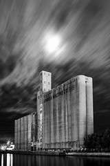 Silo City (Neil Ta | I am Bidong) Tags: longexposure blackandwhite toronto night urbandecay silos canadamalting canon35mm cloudmovement september2011 canon5dmkii