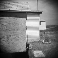 North Rustico Harbour #7 (LowerDarnley) Tags: holga pei princeedwardisland northrusticoharbour atlanticcanada maritimes houses cottages architecture walls